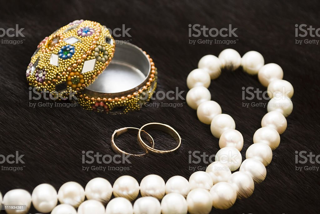 white pearls and wedding rings royalty-free stock photo