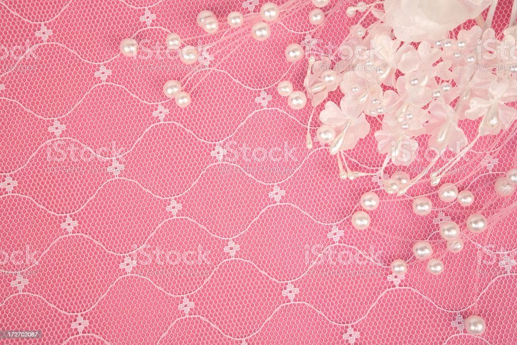 White Pearls, flower and Lace on pink background royalty-free stock photo