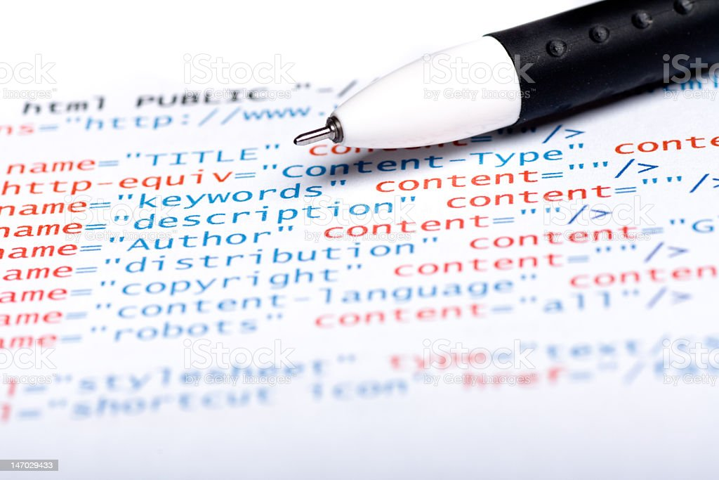 A white pen and a piece of sample html code royalty-free stock photo