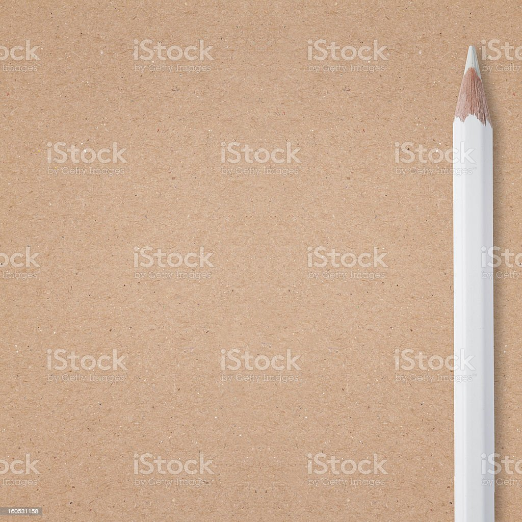 white pencil on carton background royalty-free stock photo