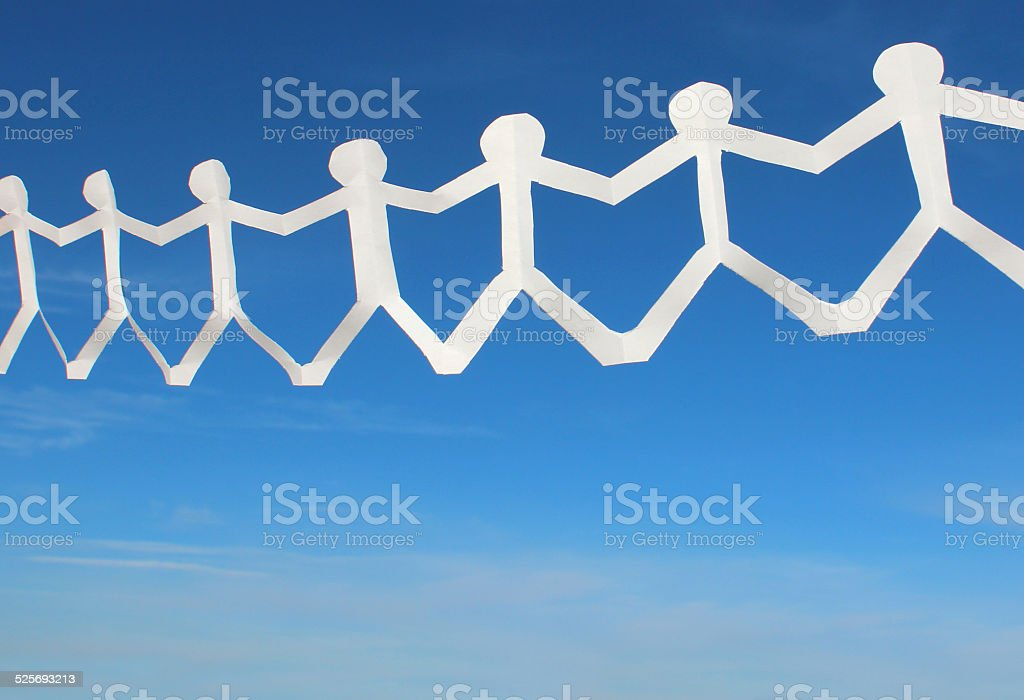 White people paper chain of dolls, men holding hands, blue-sky stock photo