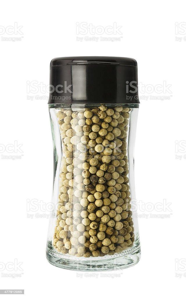 White pepper in glass bottle stock photo
