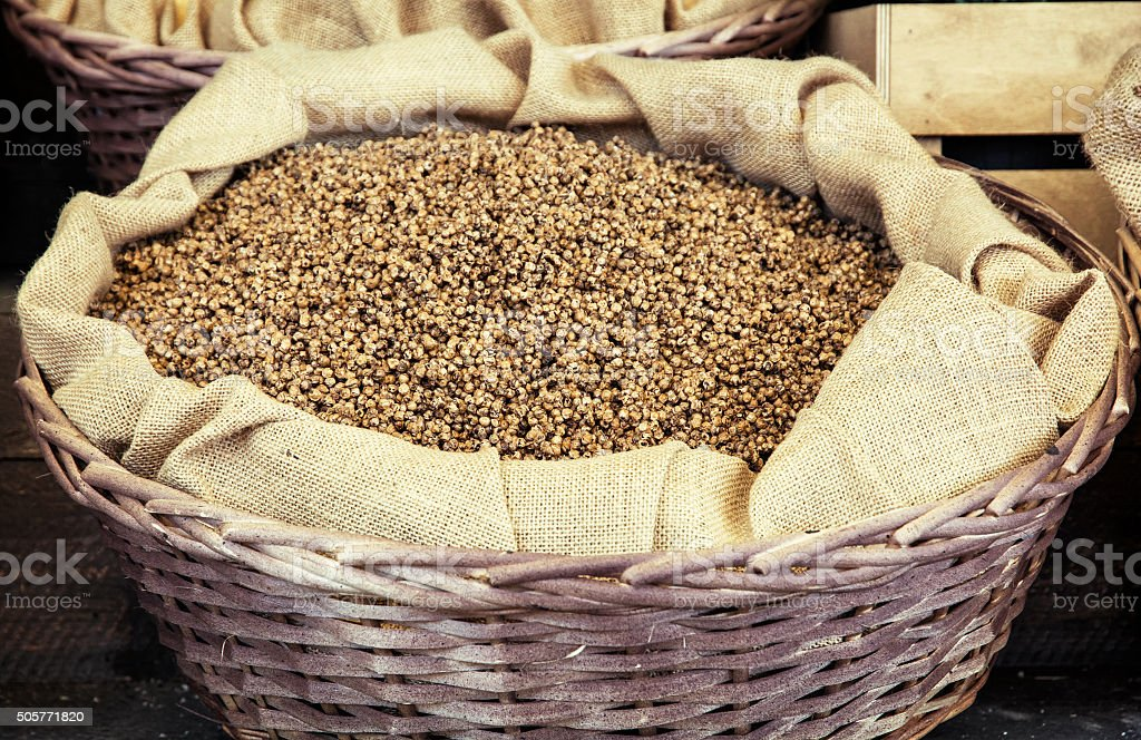 White pepper in the wicker basket stock photo