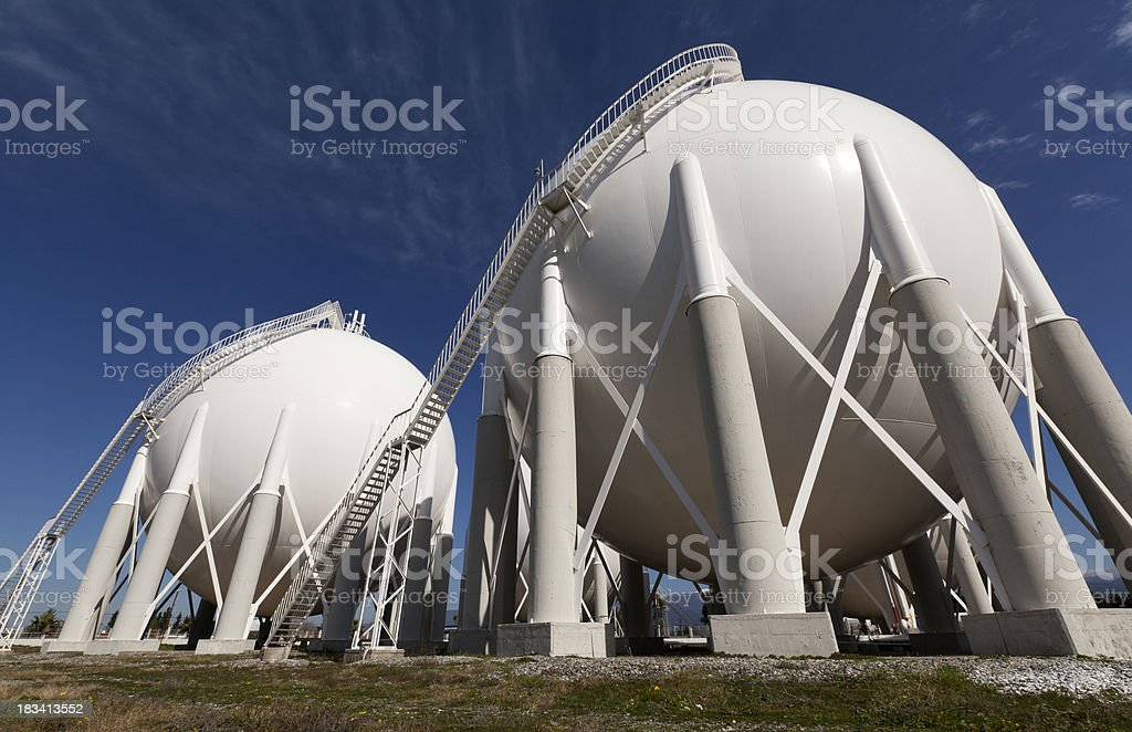White petroleum storage tanks outside a petrochemical plant stock photo