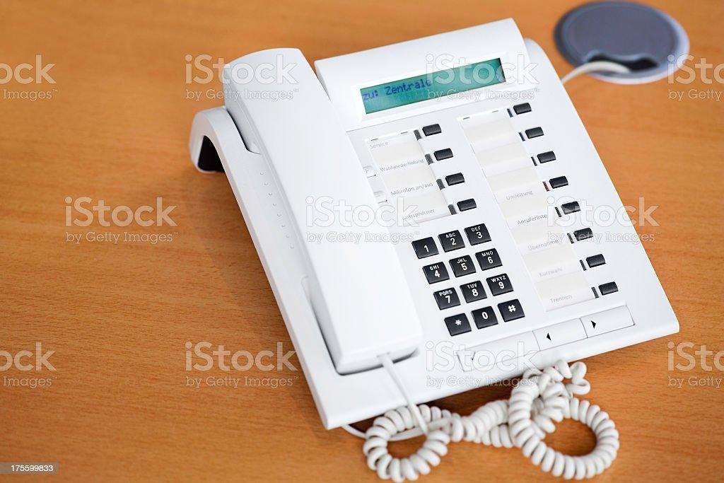 white phone on wooden desktop stock photo