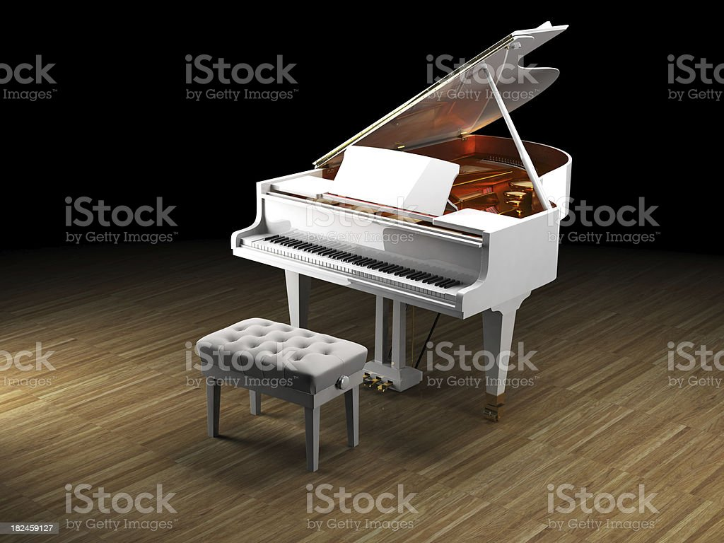 White Piano on wooden floor royalty-free stock photo