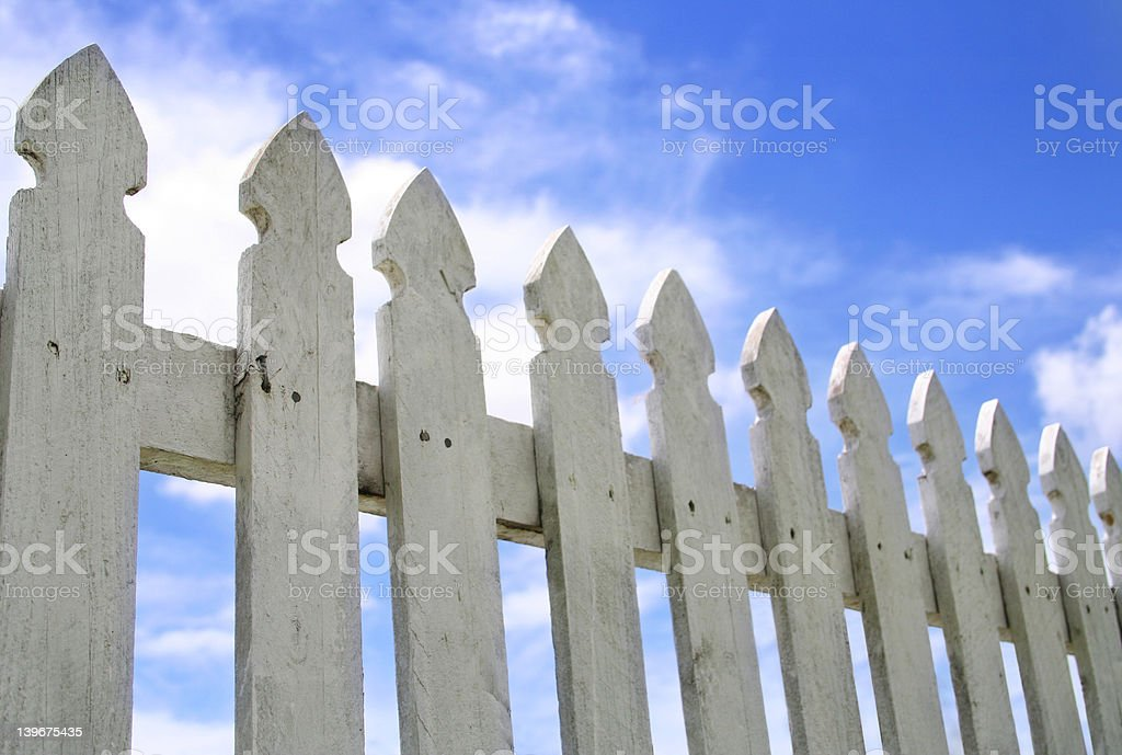 White Picket Fence and Blue Sky royalty-free stock photo