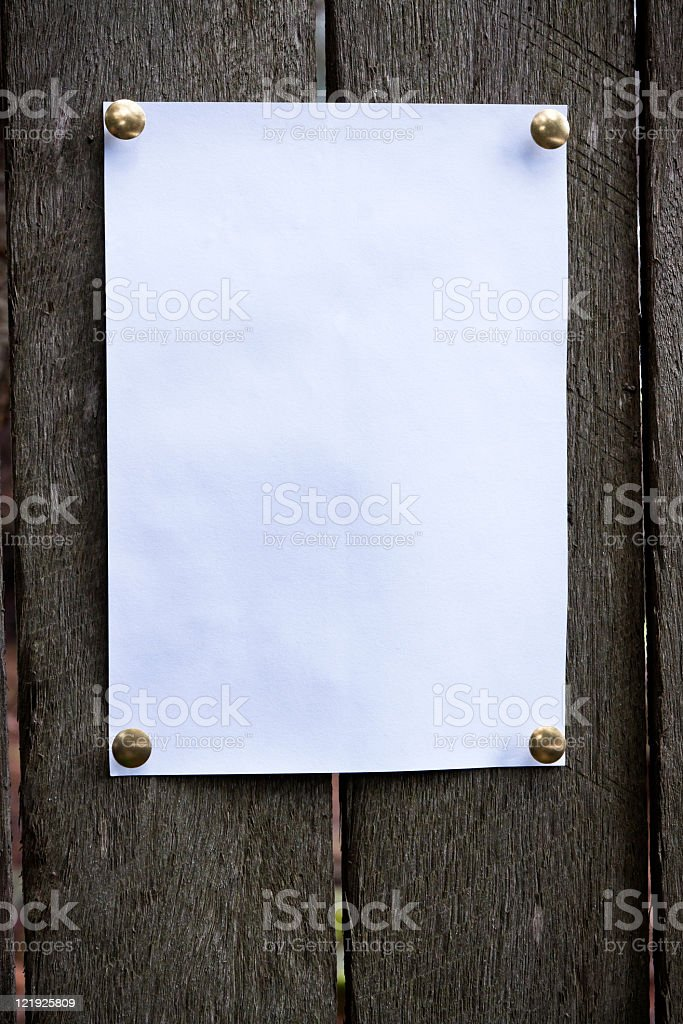 White piece of paper pinned on the wood, copy space stock photo