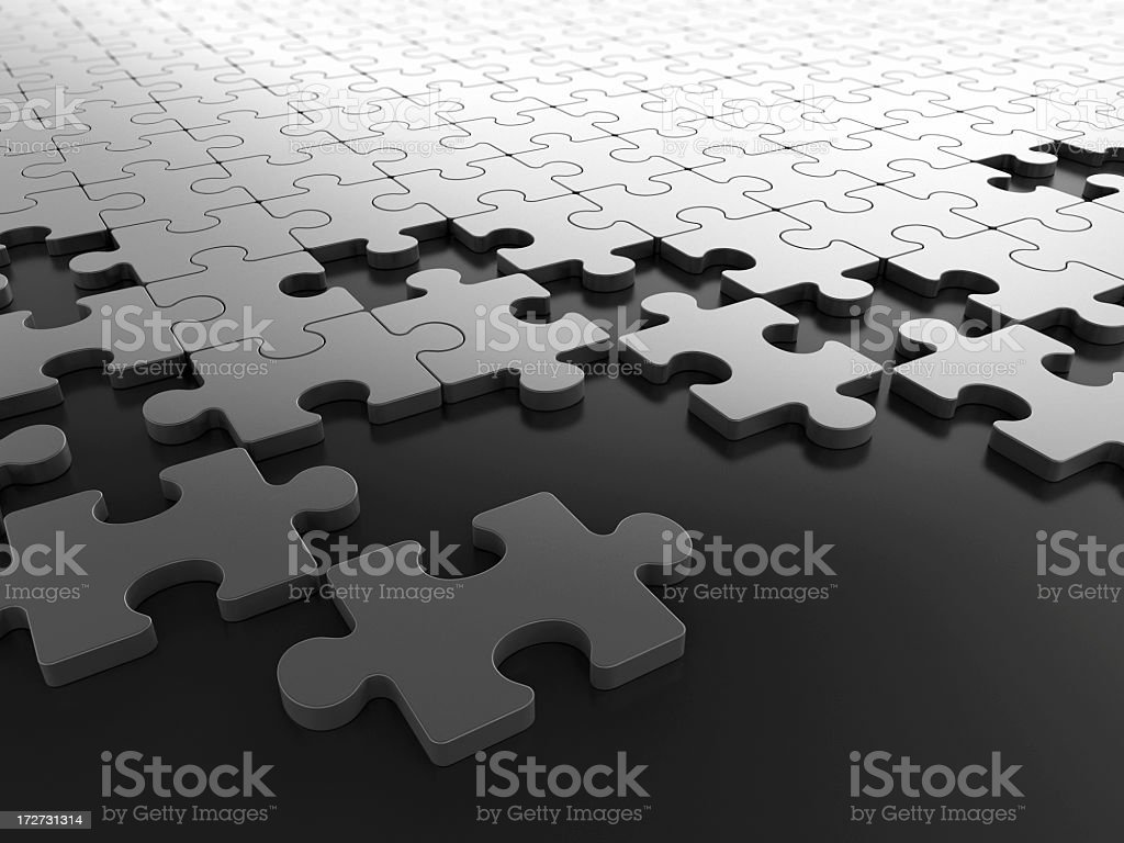 White pieces of puzzle on black table royalty-free stock photo