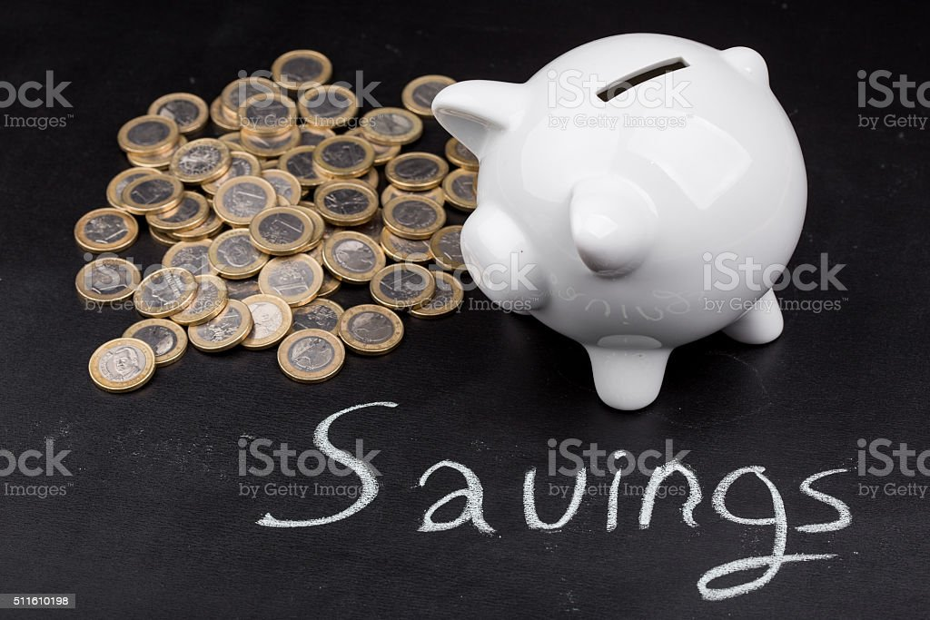 White piggy bank on blackboard stock photo