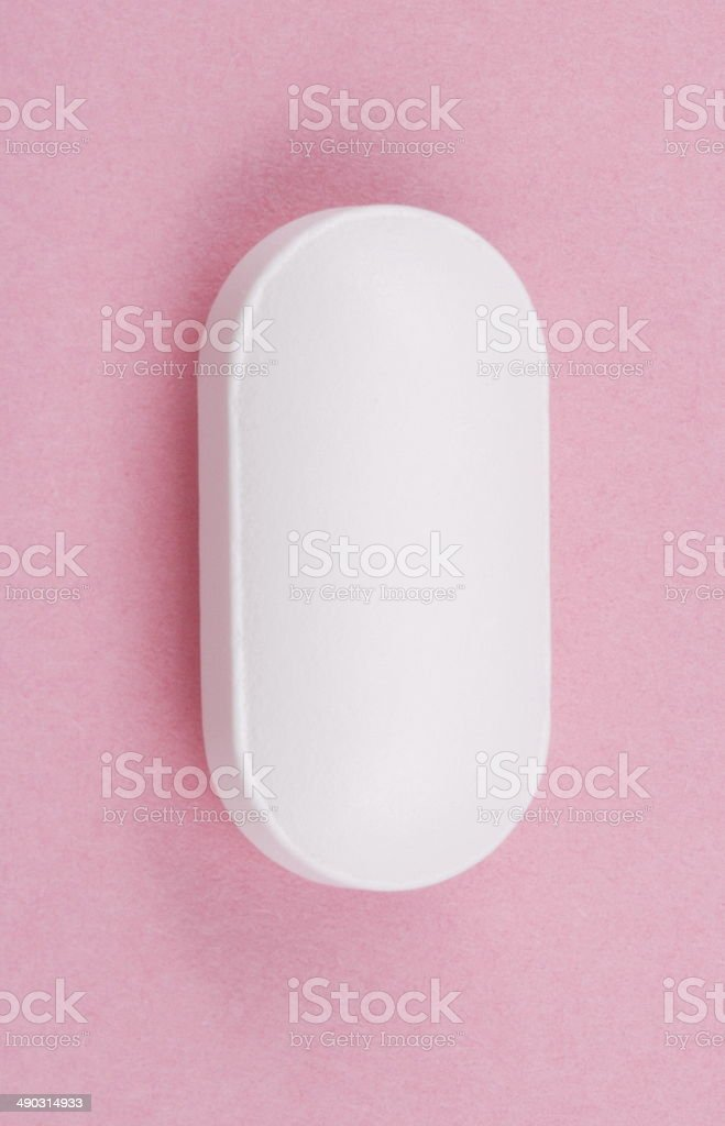 White Pill on Pink Background stock photo