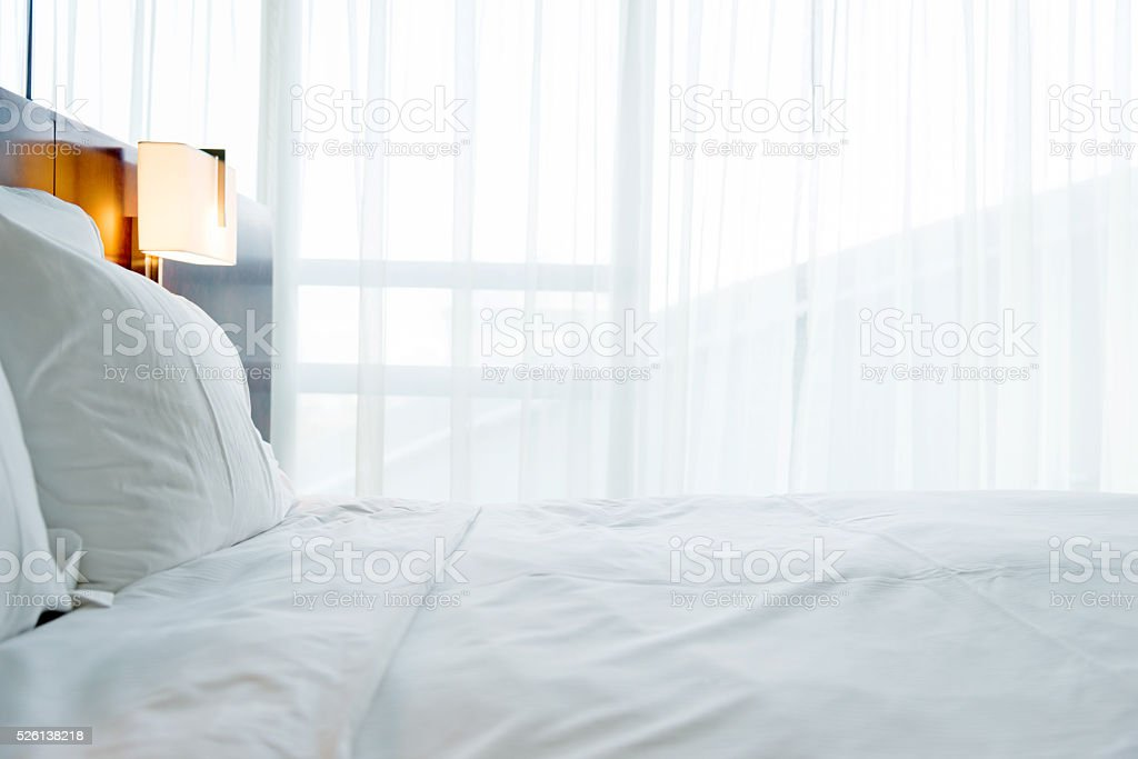 White pillows in bedroom stock photo