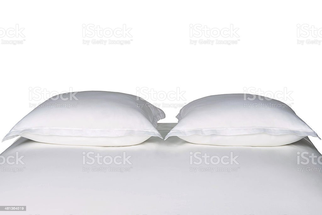 White pillows on a bed royalty-free stock photo