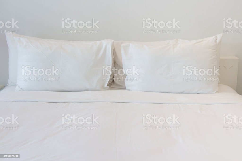 White pillows on empty bed. stock photo
