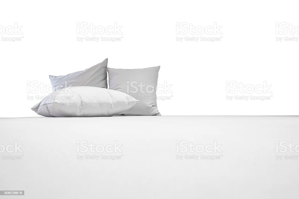 White pillows on white bed, isolated on white background stock photo