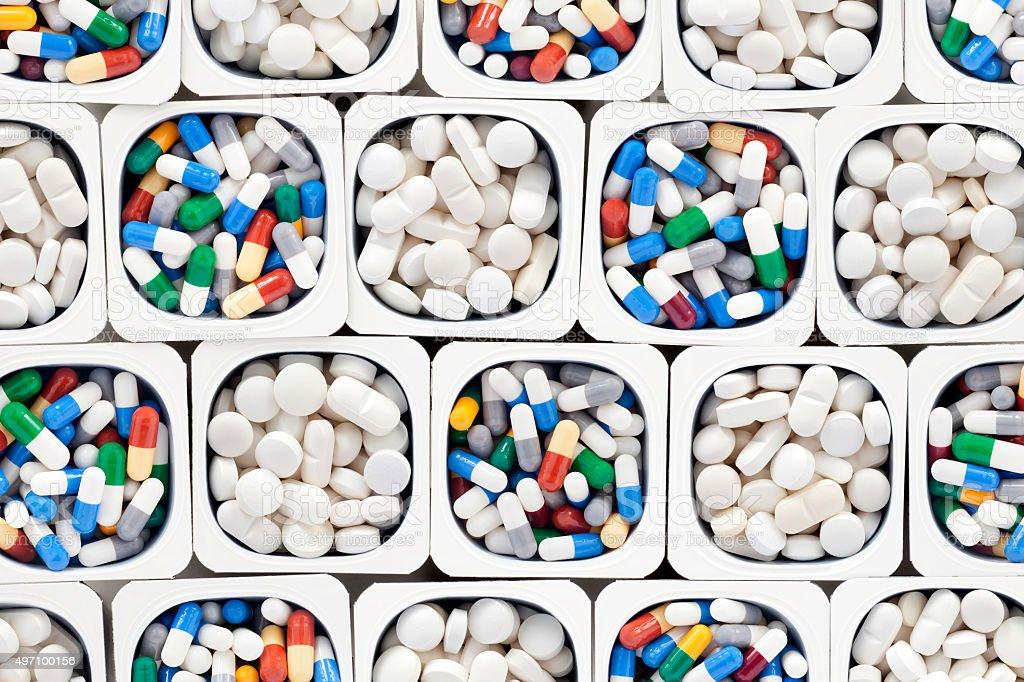 White pills and capsules stock photo