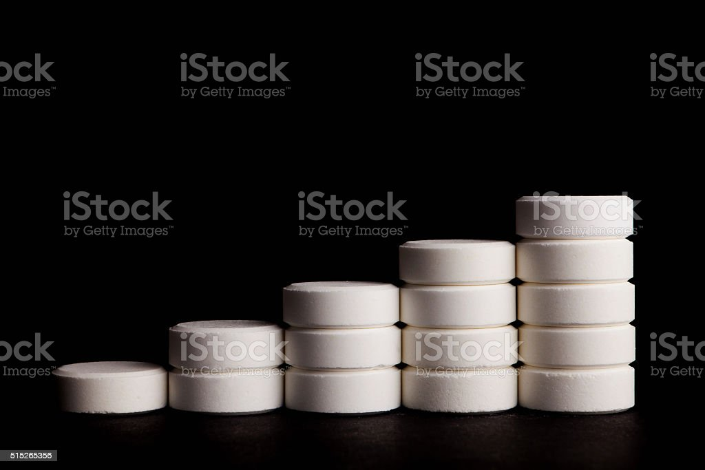 White pills in growing chart stock photo