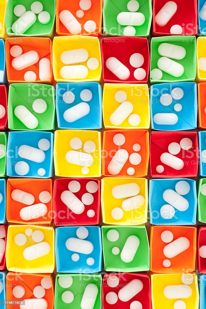 White pills in multicolored boxes royalty-free stock photo