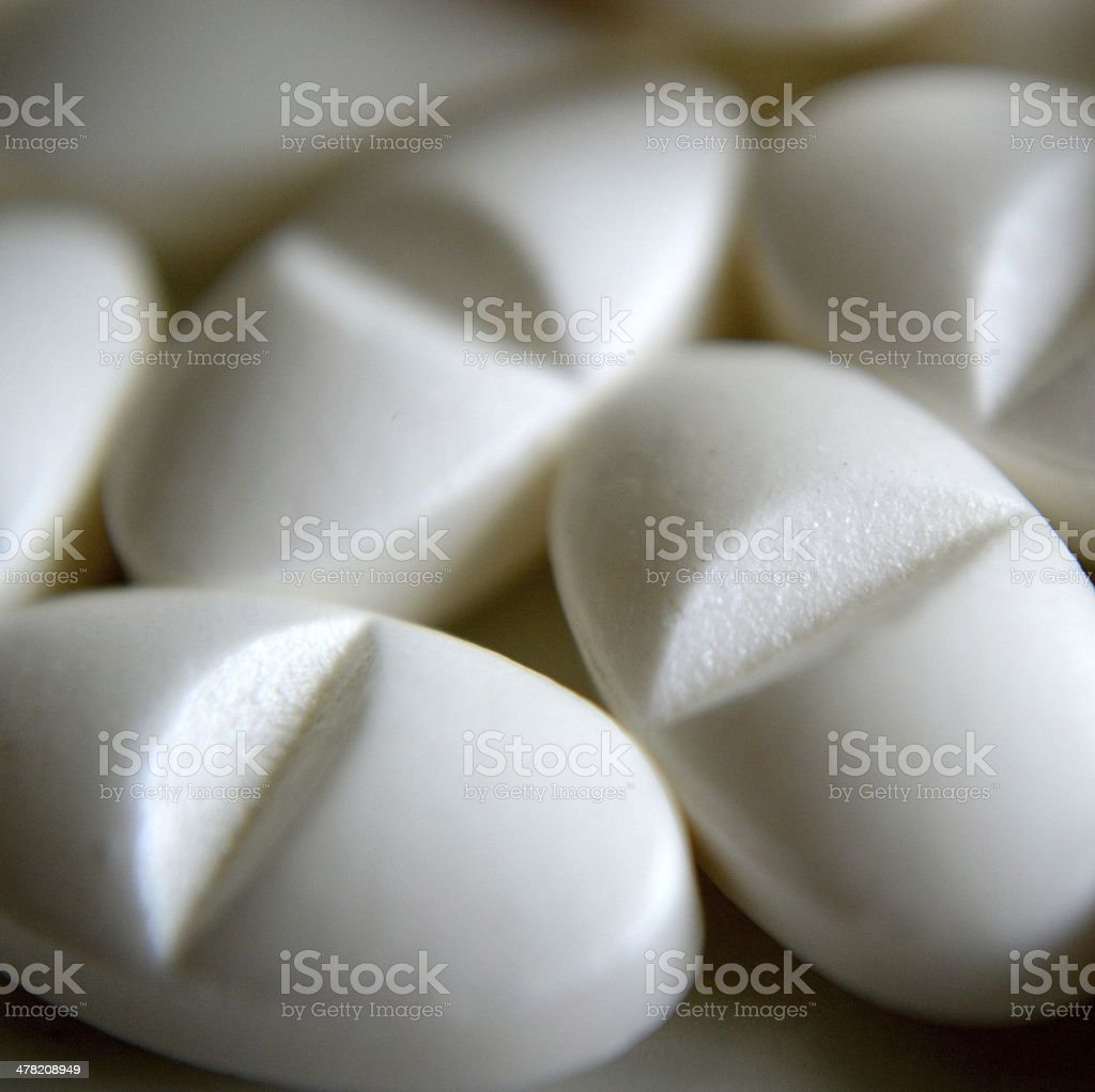 White pills stock photo