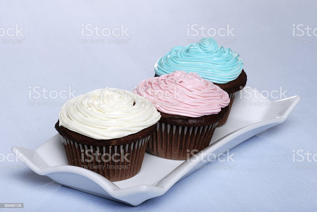 white pink blue frosted chocolate cupcakes royalty-free stock photo