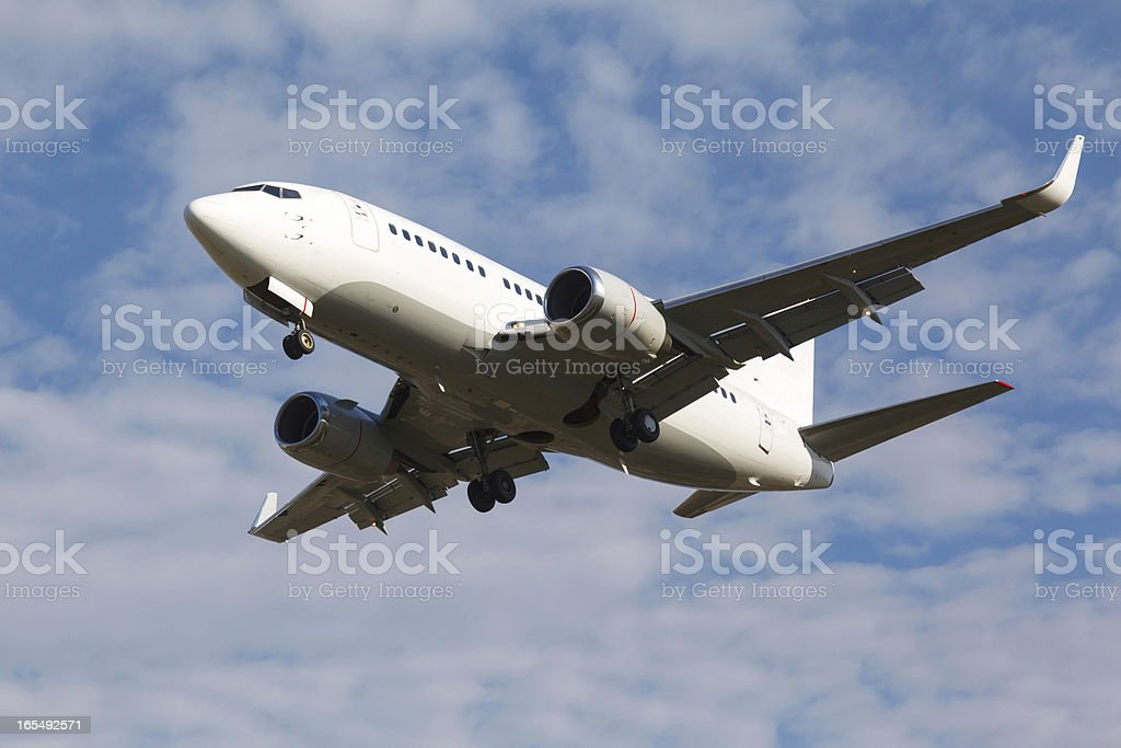 white plane with the gear royalty-free stock photo