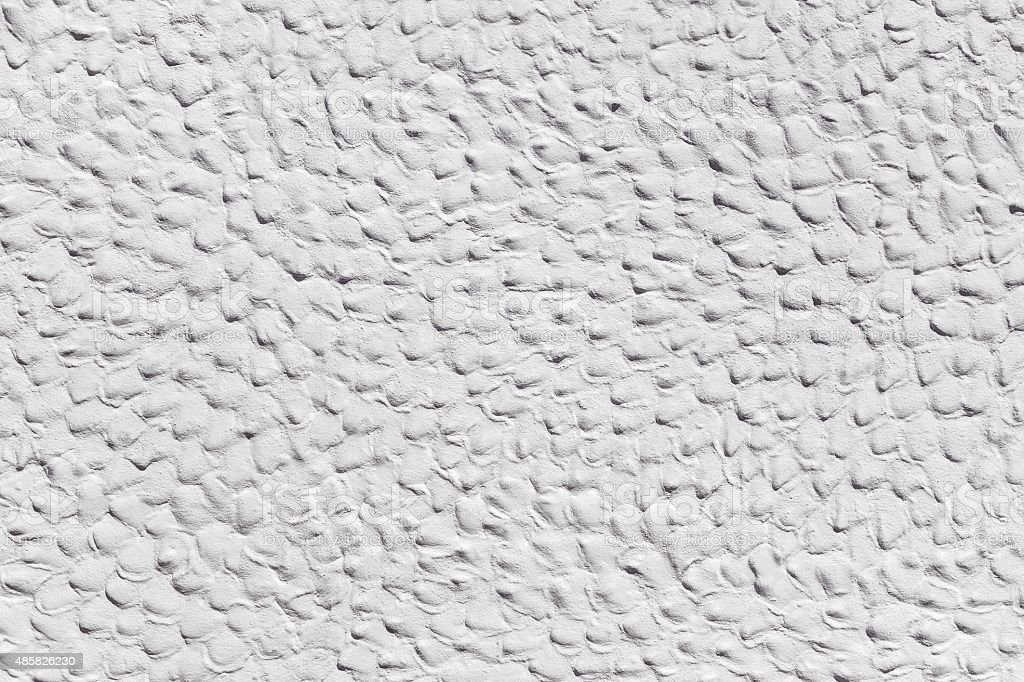 White plasterwork with humpy surface stock photo