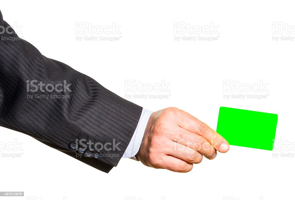 White plastic card in man hand Isolated stock photo