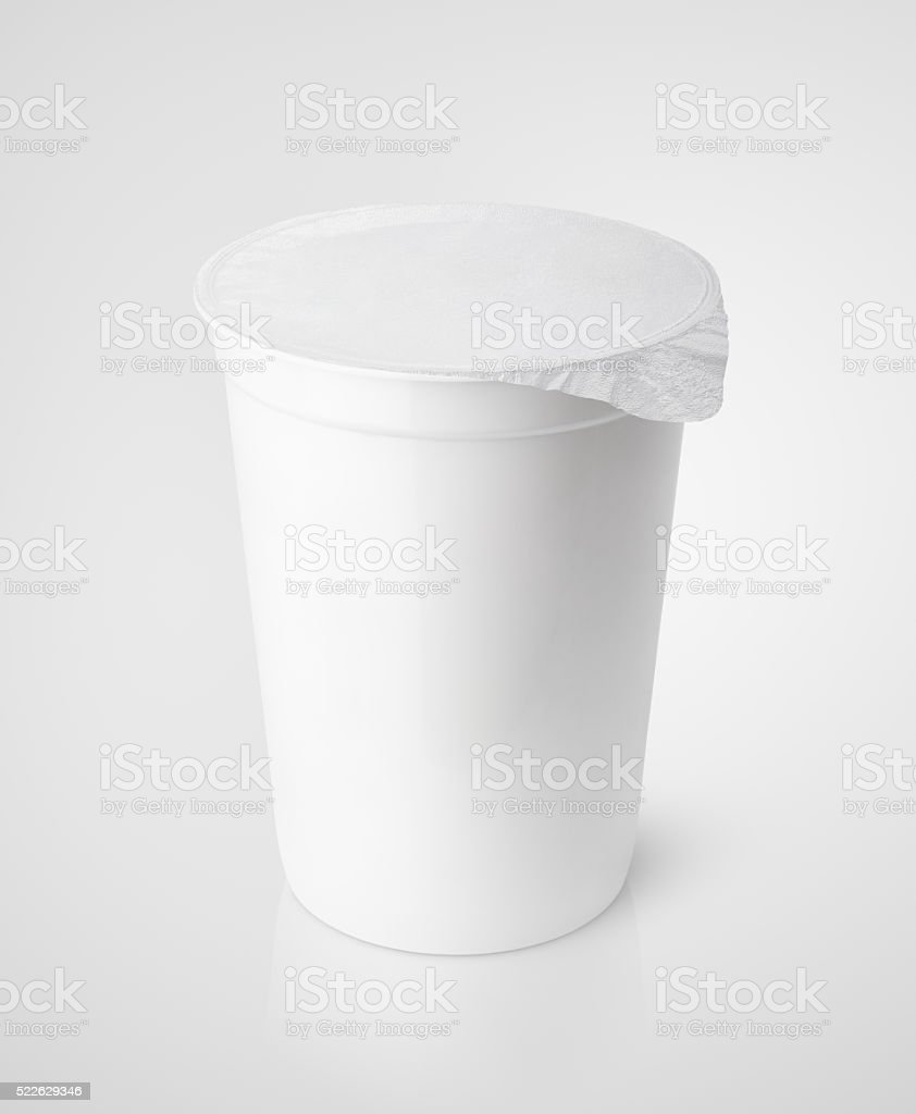 White plastic container for dairy foods with foil lid stock photo