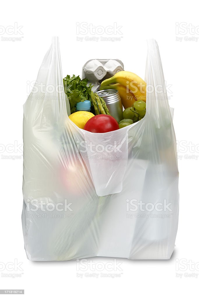 A white plastic grocery bag filled with produce stock photo