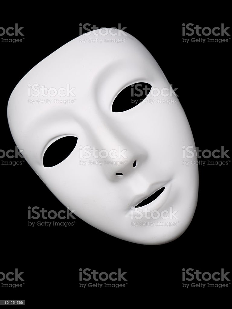 White plastic mask on black stock photo