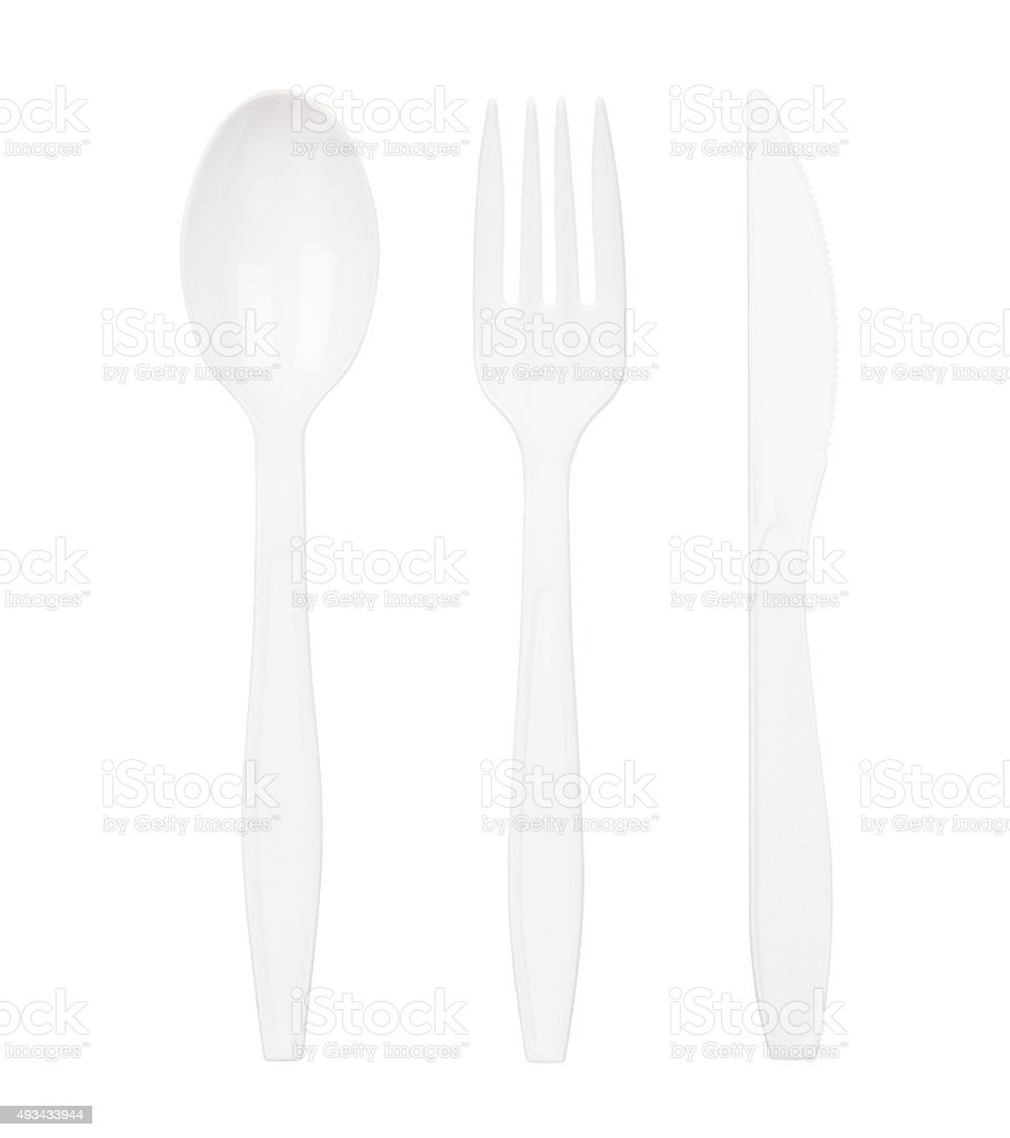 White plastic spoon, fork and knife isolated on white stock photo