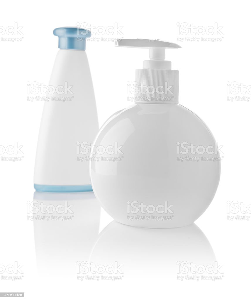 white plastical bottles isolated stock photo