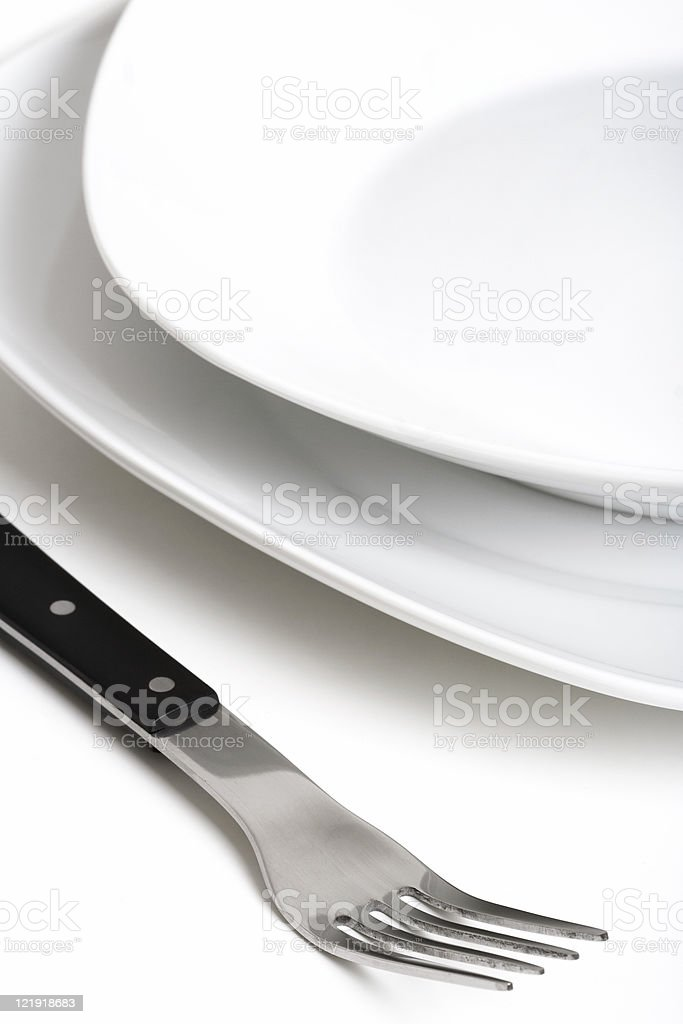 white plate and fork -series stock photo