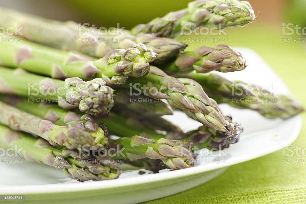 White plate filled with lots of asparagus royalty-free stock photo
