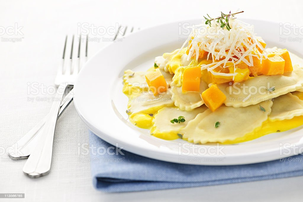 White plate filled with ravioli stock photo