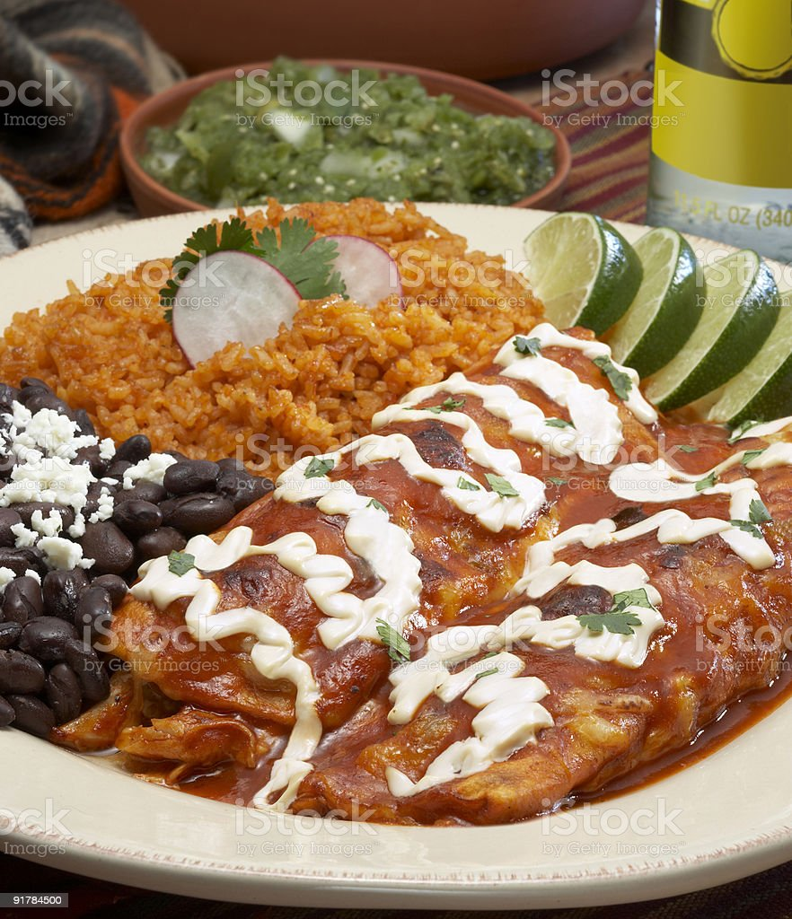 A white plate full of enchiladas stock photo