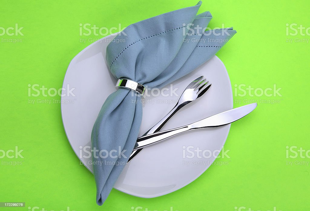 White plate, green background. stock photo