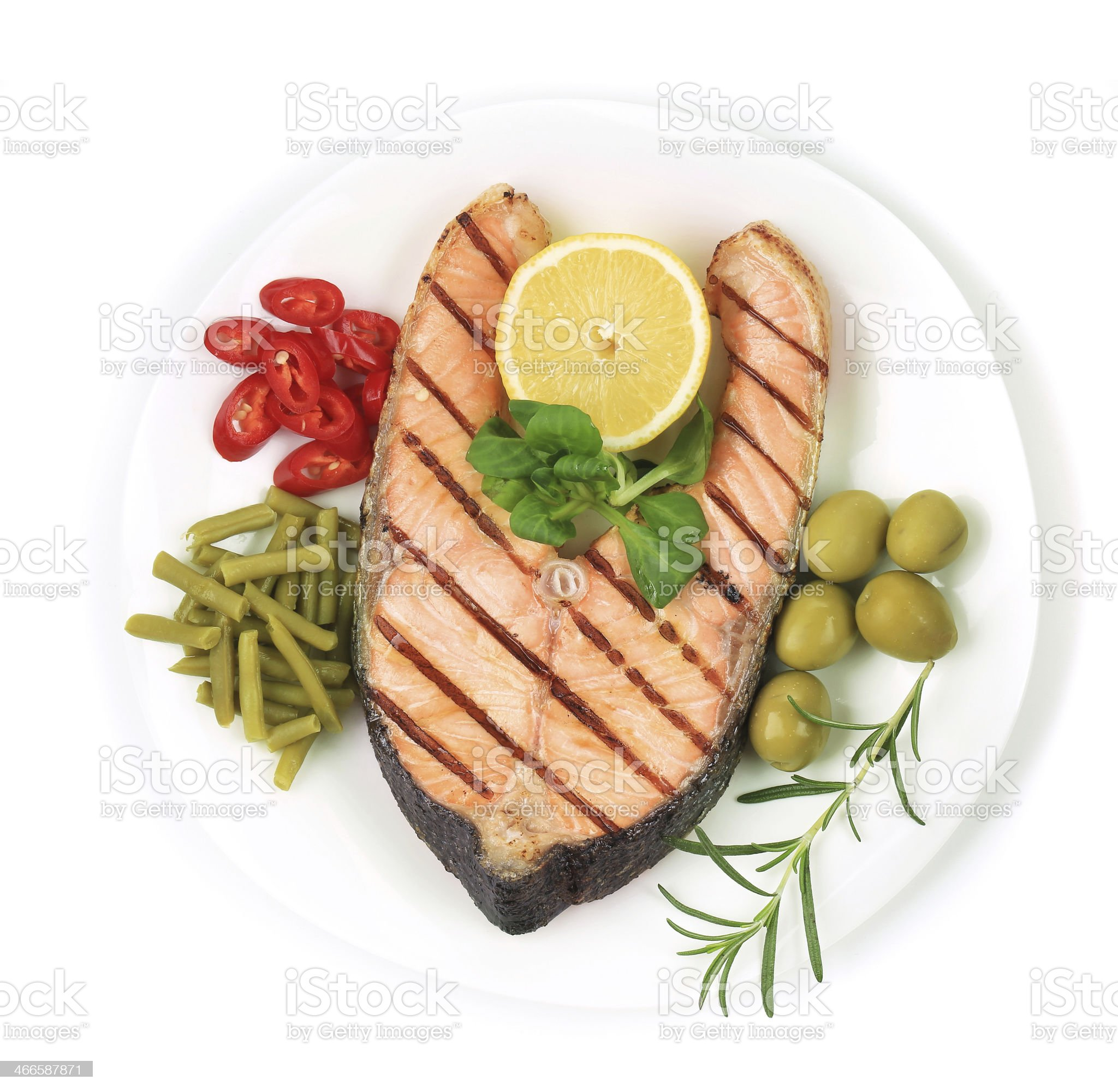 White plate of salmon steak with vegetables. royalty-free stock photo