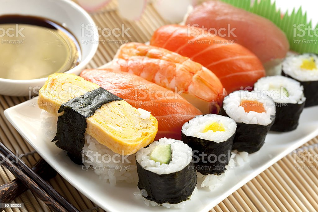 White plate of sushi with soy sauce and chopsticks stock photo