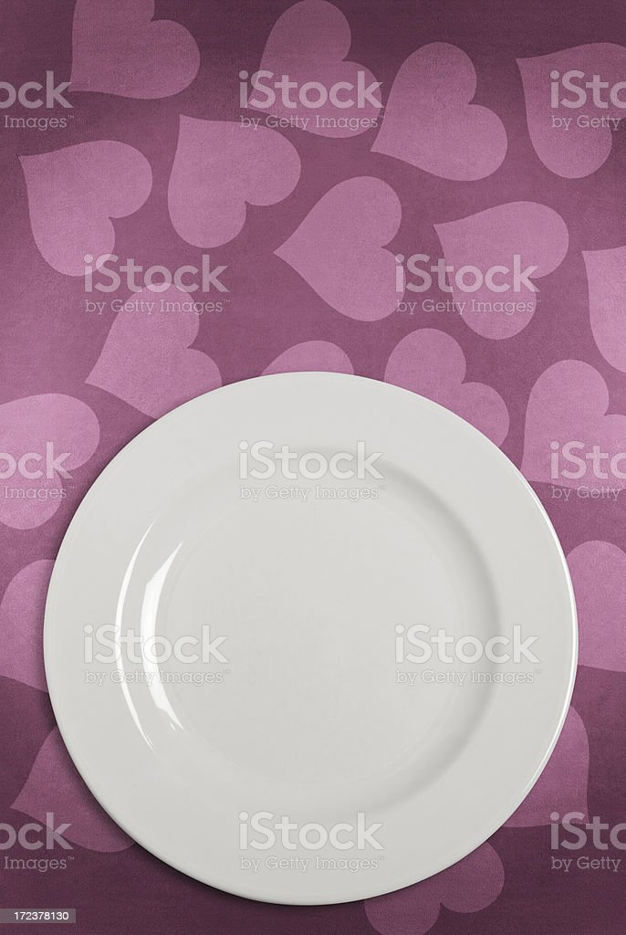 White Plate on Heart shape decorated tablecloth stock photo