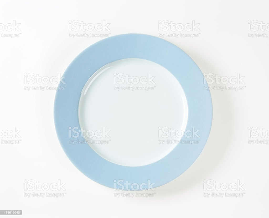 White plate with blue rim stock photo