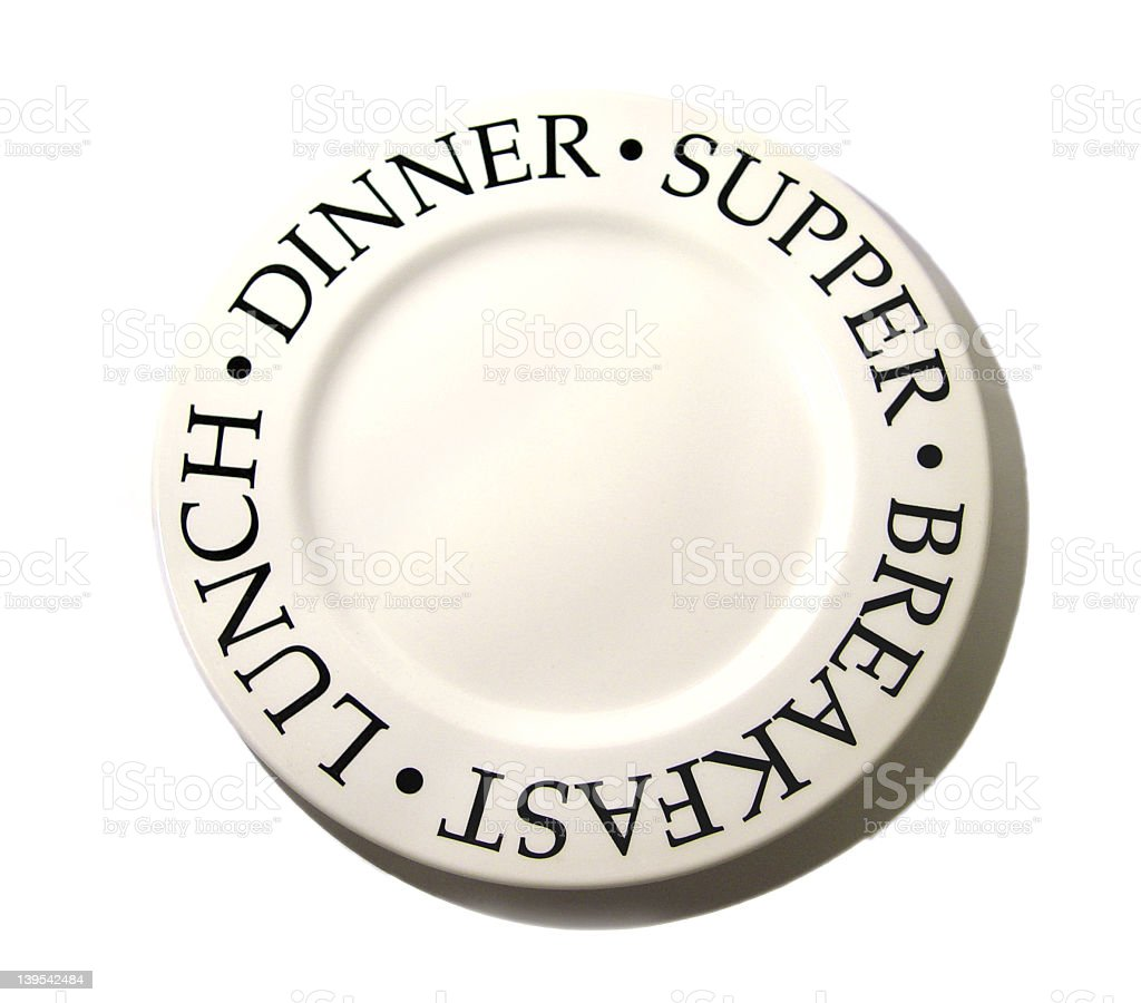 White plate with BREAKFAST LUNCH DINNER SUPPER words royalty-free stock photo