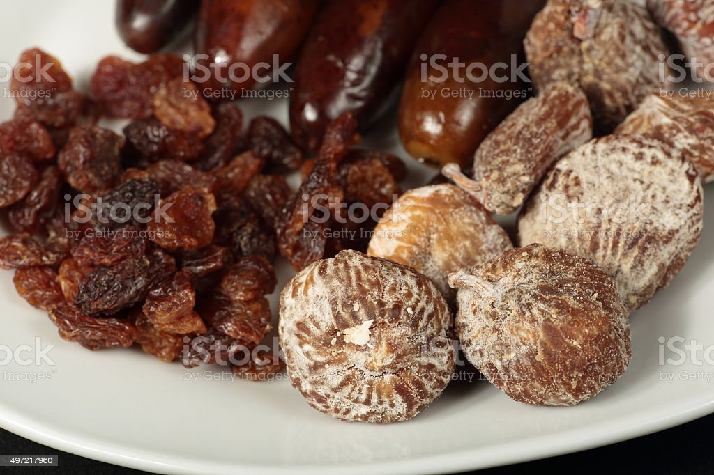 white plate with dried fruits stock photo