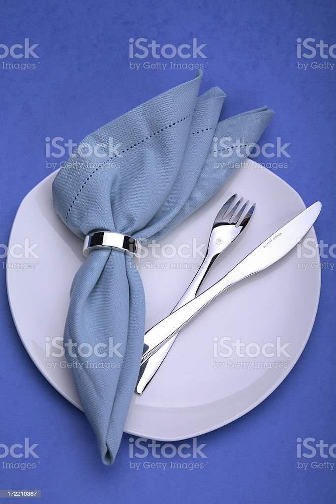 White plate with fork and knife royalty-free stock photo
