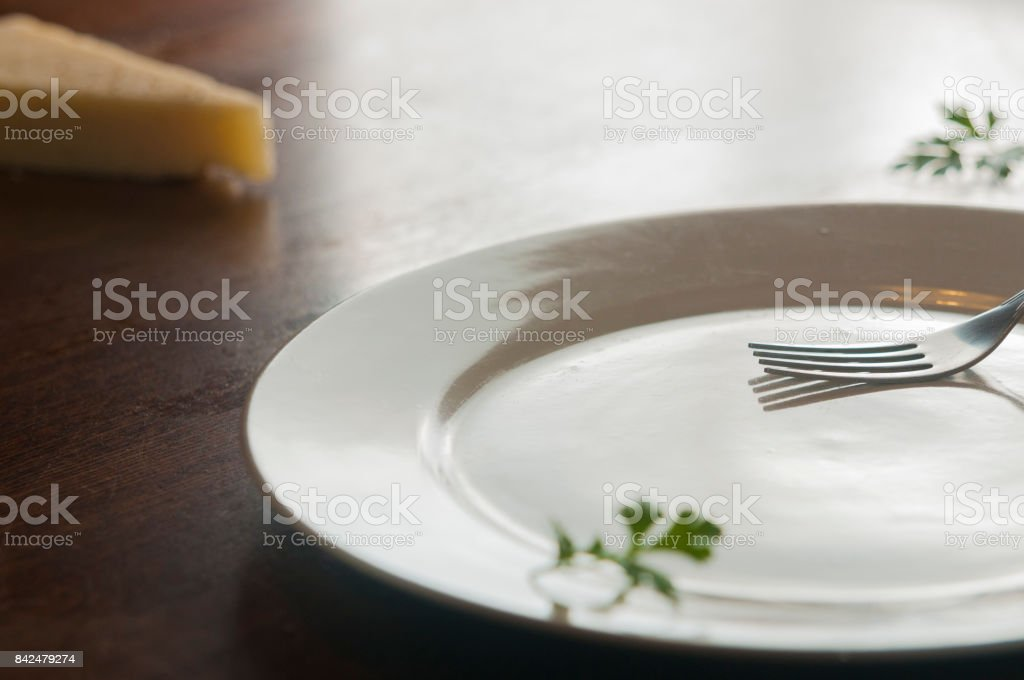 White plate with fork stock photo