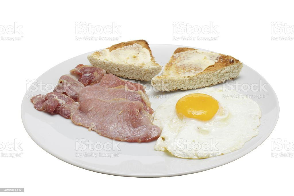 white plate with fried egg bacon, toasted irish soda bread stock photo