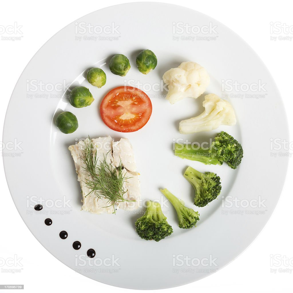 White plate with healthy food: fish and vegetables royalty-free stock photo
