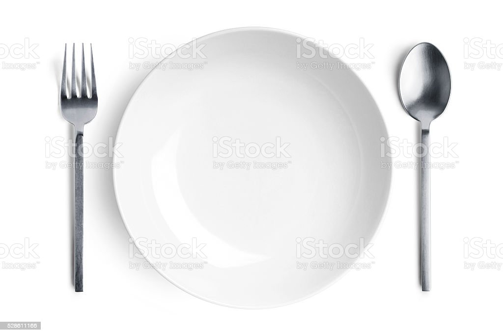 White plate with silver fork and spoon stock photo