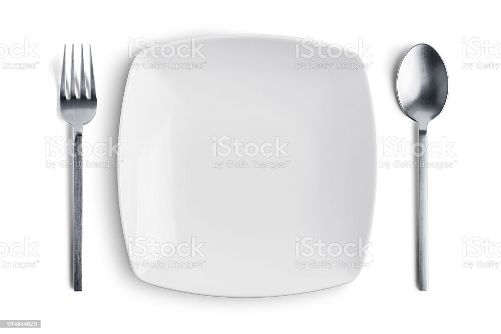 White plate with silver fork and spoon with clipping path stock photo