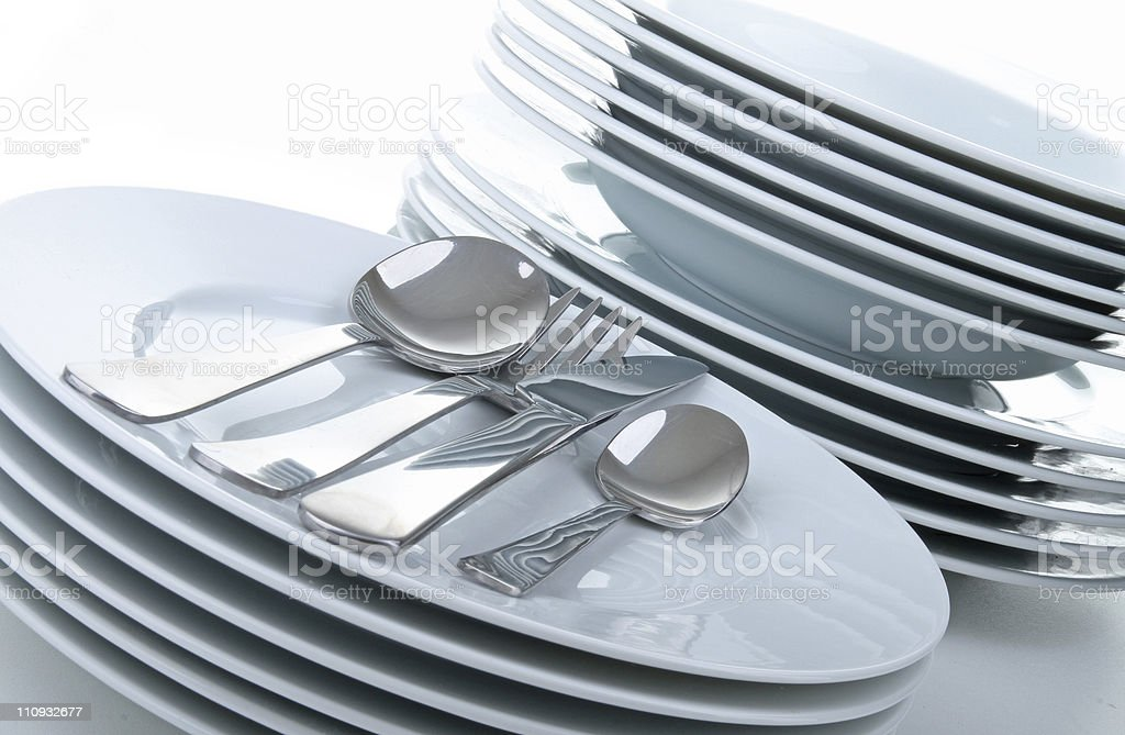 white plates and cutlery stock photo